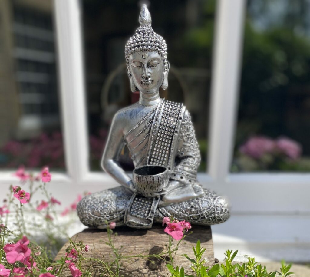 Budha, pink flowers