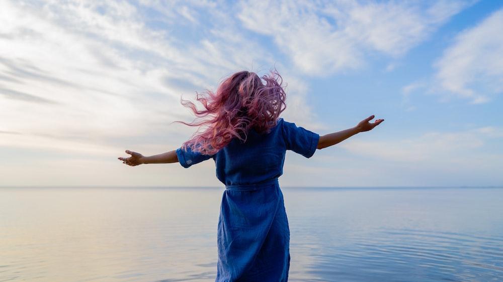 Liberation, woman, pink hair, blue sky